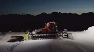 Piste machine at dawn