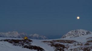 Tent on high alpine ridge in full moon