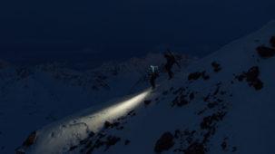 Mountaineers decending the ridge at dusk